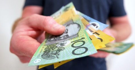 Hand fanning out Australian dollar notes